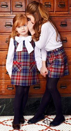 if we have all girls, matching plaid frocks.  naturally! :D
