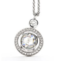Rose Cut Diamond Pendant  Nautically themed, a 0.16ct old european-cut diamond is due north over a halo of pave-set diamonds. Steering the piece hovers a bezel set 0.85 carat rose cut diamond held [...]