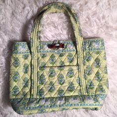 """Retired Vera Bradley, Citrus Blue and green Citrus pattern. Depth is 4"""", about 8"""" tall and about 8.5"""" wide. Handles are about 13"""" long. Bag has a toggle closure with one outside pocket and 2 inside, flip up pockets. Bag is in great condition. No stains, holes or rips. Vera Bradley Bags"""
