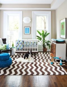 Something about the crib being next to those windows freak me out but I'm loving this rug!