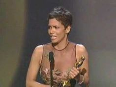 2002 ACADEMY AWARDS ~ Halle Berry wins the Oscar for Best Actress for MONSTERS BALL (2001), becoming the first African-American woman to win the Academy Award for Best Actress. On this same night, Denzel Washington became the second African-American to win an Oscar for Best Actor, winning for TRAINING DAY (2001). The first, Sidney Poitier, who won in 1964 for LILLIES OF THE FIELD (1963), is in the audience to see Denzel Washington & Halle Berry win. (5:38) [Video]
