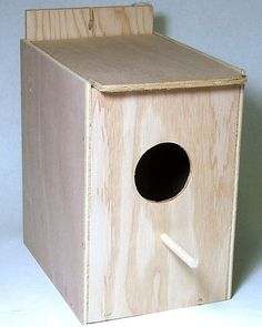 "Wood Nest Box For Budgies Or Lovebirds Wooden Budgie Nest Box. Also good for Lovebirds and similar sized birds. Mounts to Inside of Cage Dimensions: 6.0"""" W x 7.0"""" D x 7.25"""" H Plywood & Luan Plywood"