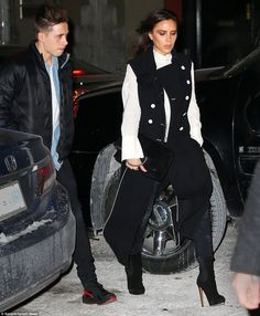 Stylish streak: Victoria later showed off her slim shape in a chic black and white look as...