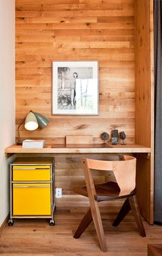 Small Home Office Idea - Make use of a small space and tuck your desk away in an alcove // Wood panels lining the wall of this alcove designate the office space, and the mini yellow filing cabinet adds a fun pop of color, livening up the corner.