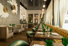 Imagine hosting a dinner party at this Los Angeles restaurant! Green goblets galore!