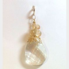 Elegant Rutilated Quartz Teardrop pendant with cognac citrine briolettes. Gold vermeil and brass findings. Adjustable bale.  Healing Properties: Rutilated quartz is the stone of truth. It stimulates the wearers capacity for self-healing. Citrine brings warmth, energy, and creative powers to its wearers. This is an especially beautiful and powerful combination of energies.  Made with love by Goddessandco. GGP0534