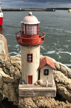 Lighthouse gifts - model lighthouse, novelty lighthouses, decorative lighthouses, model lighthouses for sale, lighthouse candle holder, t-light holders in bulk, t-light holders wholesale, wooden lighthouses, personalised lighthouses, quirky lighthouses, seaside and coastal decor in glass and other lighthouse ornaments from Dorset Gifts in the UK - hanging lighthouse ornaments and other nautical and maritime gifts for the nautical home, bathroom, garden or boat or as nautical window decor…