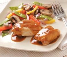 """Curry Citrus Chicken Recipe -To brighten dark midwinter days, Marcy Hall relies on her mouthwatering microwave chicken with its sunny splash of citrus and warm dash of curry. """"The thick sauce is also great served over rice.""""—March Hall, Visalia, California"""