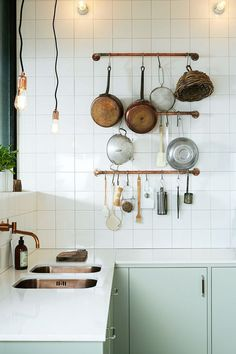 kitchen with white tile backsplash and mint green cabinets. / sfgirlbybay