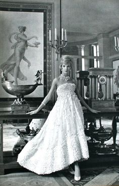 Portrait of a lady wearing a white tulle ballgown by Christian Dior. L'Officiel December, 1958.