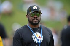 Coach Mike Tomlin watches a drill during practice.