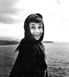 Audrey Hepburn photographed by Edward Quinn at the harbour of Monaco in 1951. © edwardquinn.com