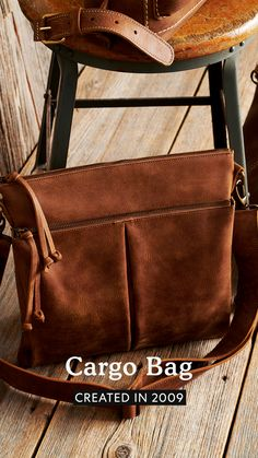A reissue of an iconic Roots style, our Cargo Bag is designed and handcrafted in Canada with one main compartment, two exterior zipper pockets, an interior zipper pocket and a two-compartment slip pocket. Fully lined, it features an adjustable shoulder strap for added functionality. Briefcase, Roots, Messenger Bag, Shoulder Strap, Satchel, Canada, Exterior, Pockets, Zipper