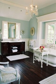 A bathroom with wood tile and high ceilings.... Absolutely beautiful