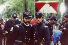"""""""Tom Chamberlain"""" (C. Thomas Howell) left and the """"Cocky Lieutenant"""" (Brian James Egen) right during a break in the filming on the Little Round Top set during the filming of Gettysburg."""