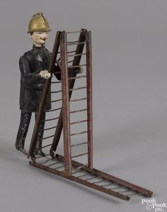 Martin hand painted tin clockwork fireman with folding ladder, overall - 21 1/2'' h. - Price Estimate: $300 - $400
