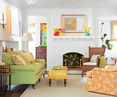 The pops of color against the all white background are stunning! More decorating ideas: http://www.bhg.com/decorating/small-spaces/strategies/small-space-decorating/