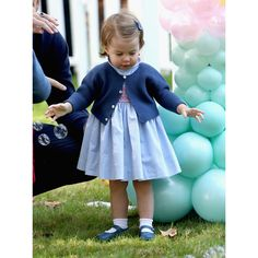 Charlotte looked adorable for her first engagement wearing a handsmocked dress by Pepa & Co, which she paired with a navy button down cardigan by Mi Lucero and matching Mary Jane shoes. | Royal Canadian Tour, Sept. 2016