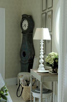 Love the antique clock in the corner! Farm House | Cathy Kincaid Interiors