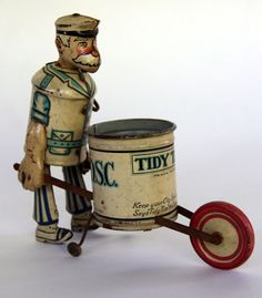 Tidy Tim Tin Litho Wind UpToy  Circa 1933 | Keep Your City Spic and Span Says Tidy Tim the Clean Up Man. This bizarre 1930s tin wind up toy sports excellent lithography.