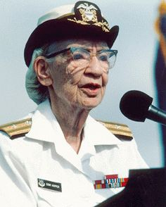 """Rear Admiral Grace Hopper, USNR (1906-1992).  Hopper earned a Ph.D. in Mathematics when it was rare for  women to college. She joined the WAVES in WWII and retired in 1986 at the age of 80 with the rank of Rear Admiral, being the oldest member of the Navy on active duty.  Grace Hopper was also one of the foremost pioneers in the field of computing - she was a programmer on the Mark I at Harvard Labs during WWII."
