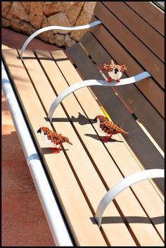#LEGO Birds.  What a great photo.  Wouldn't you just love to be walking along and see little LEGO birds sitting on a bench?