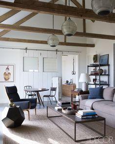 French light fixtures + vintage decor in Hamptons cottage by Robert Stilin Interiors via elle decor