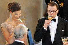 Crown Princess Victoria and fiance Daniel Westling give a toast as they attend the Government Pre-Wedding Dinner for Crown Princess Victoria of Sweden and Daniel Westling at The Eric Ericson Hall on June 18, 2010 in Stockholm, Sweden.