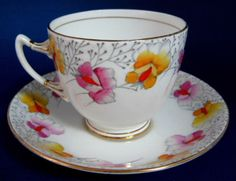 Roslyn Art Deco Tea Cup And Saucer Sweet Pea Pink Yellow Hand Painted 1930s