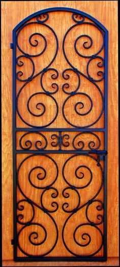 Wine Cellar Door or Gate - Wrought Iron Scalloped Scroll. $895.00, via Etsy.