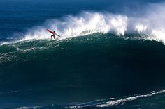Surfers face monster waves as Big Wave Tour hits Nazaré – in pictures