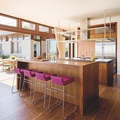 Magenta is an unexpected pop of color in a kitchen that is mostly wooden #LuxeCA May/June Interiors: @timclarkedesign  Architecture: @grantkirkpatrick  Photo: @joefletcherphoto  @sandow . . . #instaluxe #luxuryinteriors #kitchendesign #magenta #popofcolor #calidesign #monday  #Regram via @luxemagazine