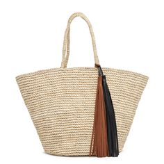 Crafted entirely by hand in Ecuador from natural Toquilla straw, our straw bag is an ode to heritage artisanship. Its beautiful Italian leather tassel, made in the U.S., provides elegant movement. This meticulously made piece delivers an all-natural aesthetic that translates perfectly to the effortless days of summer.  Due to the handwoven nature of the straw, the handles will shape as the bag is carried. The dimensions of each uniquely handmade piece may vary slightly.