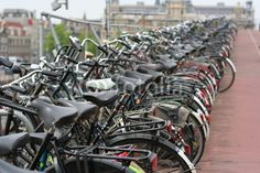 bicycles parking next to the rail station in Amsterdam