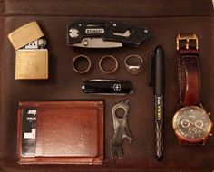 Capsule Wallet: Cognac     Zippo Lighter Solid Brass with Butane Lighter Insert     Stanley Folding Utility Knife     Pilot Varsity Disposable Fountain Pen     Fossil Ansel Chronograph Rose Gold Ion-plated Mens Watch FS4639     Clan Signet Ring     Texas Coin Ring Made from a Quarter     14K Gold Wedding Band     Swiss Army Pocket Knife     Gerber Shard