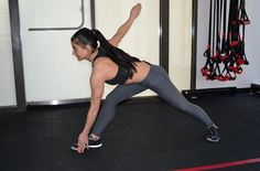 16-Minute Tone-Everything Workout: Esquiva Lunge | Form Tip: Throughout the movement, your left foot should remain still and stable with toes pointing forward.
