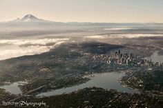 Emerald City from Above - A view of Seattle with all the major features of the region: Lake Union, Elliot Bay, Lake Washington, downtown Seattle, I-5, I-90 floating bridge, Aurora Bridge, Boeing Field, Seatac Airport, Mt. Rainier, and even Mt. St. Helens. By Thatcher Photography.