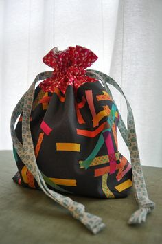 I think I need to make a 'Washi' drawstring bag, too!