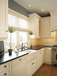 Traditional Kitchen with arizona tile, BENGAL BLACK, granite, Farmhouse sink, Raised panel, L-shaped, Soapstone counters
