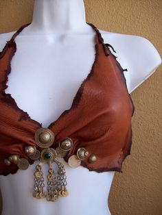 Auburn Gypsy Halter Bra by ArchaicLeatherworks, $85.00 -- Made from tattered scraps of hand dyed deerskin, tribal coins and charms, and Turkish buttons, this bra fits a B or C cup (depending on how much covereage you want), with adjustable tie straps around the back and neck.