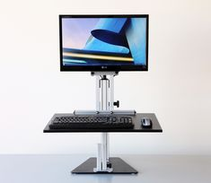 Kangaroo sit-to-stand desktop riser from Ergo Desktop. Two independently adjustable platforms make this product line the most ergonomically correct option for desktop risers. Adjustable Standing Desk Converter, Adjustable Height Desk, Adjustable Table, Sit Stand Desk, Sit To Stand, Best Standing Desk, Standing Desks, Desk Gadgets, Treadmill Desk