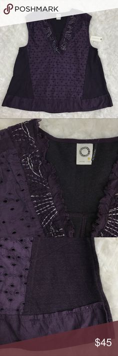 """Anthropologie Akemi + Kin Cadiz Purple Top NWT Cadiz Top from Anthropologie Akemi + Kin in dark pruple. Has silver threadig embroidery along the raw finished neckline. Eyelet cutouts in the front and solid cotton along the sides and back. Webbing detail along the shoulder. Pleated back. Length measures about 24"""" and bust at 19"""". 64% polyester and 34% cotton. Anthropologie Tops Tank Tops"""