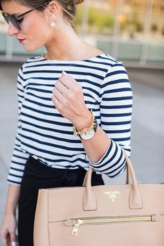 Three quarter sleeve striped tee + black skirt + nude bag