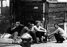 1970's NYC- In another raw image from the photographer, a group of men cluster together during a dark time in the citys history. The Lower East Side was transformed in the 90s, with gentrification contributing to the trendy Bowery neighborhood of today.