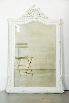 white ornate floor mirror