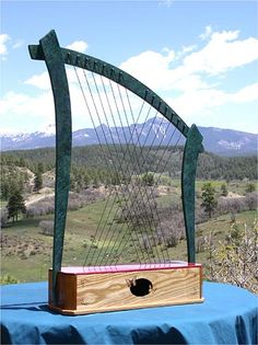 An Aeolian harp (also wind harp) is a musical instrument that is played by the wind. Named for Aeolus, the ancient Greek god of the wind, the traditional Aeolian harp is essentially a wooden box including a sounding board, with strings stretched lengthwise across two bridges. It is often placed in a slightly opened window where the wind can blow across the strings to produce sounds.
