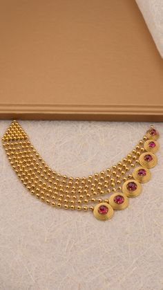 The necklace of seven graduating gold layers accented with vibrant hues. Gold Mangalsutra Designs, Gold Earrings Designs, Gold Jewellery Design, Bridal Necklace Set, Gold Necklace, Mangalsutra Bracelet, Indian Bridal Jewelry Sets, Filigree Jewelry, Golden Jewelry