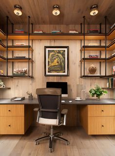 This modern home office is lined with wood and has steel and wood open shelving. #HomeOffice #InteriorDesign #Shelving
