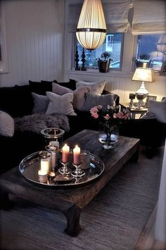 I love how cozy this #livingroom looks even with the cool and dark colors.