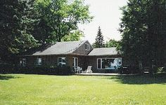 This spacious cottage is situated on an expansive private lot and sandy beach on the south side of Torch Lake. The unobstructed view from the house and deck is down the center of the lake, which boasts a beautiful sandy ...